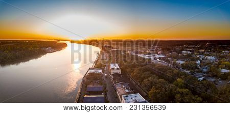 Aerial view of River Street in Savannah, Georgia at dawn.