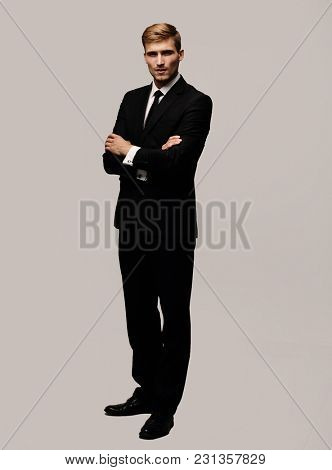 portrait in full growth serious businessman.