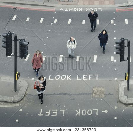 London, Uk- Mar 13, 2018: High Perspective View Of Pedestrians In The City Of London Crossing The St