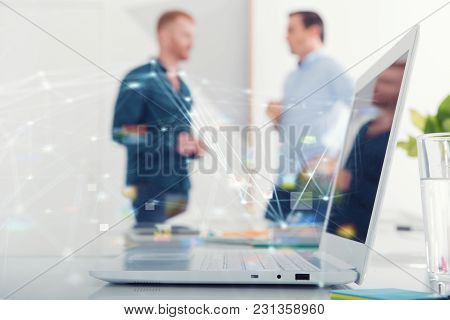Businessman In Office Connected On Internet Network With A Computer. Concept Of Startup Company