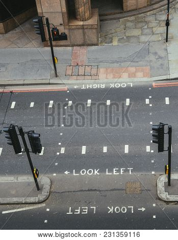 High Perspective View Of Empty Pedestrian Crossing In The City Of London. Iconic Look Left And Look