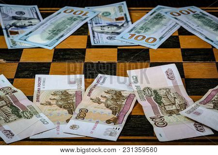 Chess Board With Cash And Chess On A Dark Background