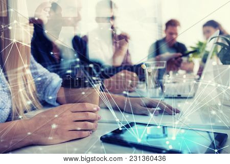Businessperson In A Modern Office Connected On Internet Network. Concept Of Partnership And Teamwork