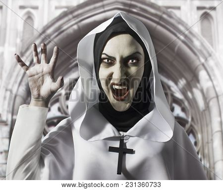 Scary Evil Nun With Fangs And Cross On Her Neck Screaming. Halloween Concept, Black Magic.