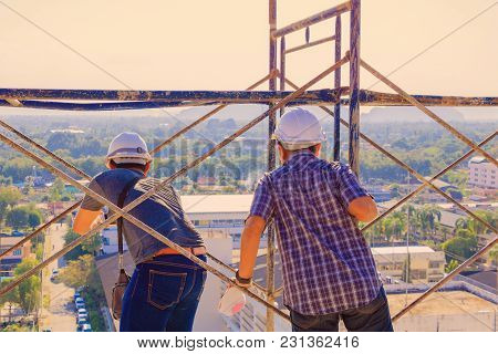 Engineer Consult Construction Site To Plan Development On Housing High Rise Building
