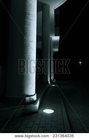 The Columns Of The Modern Building Illuminated From Below.