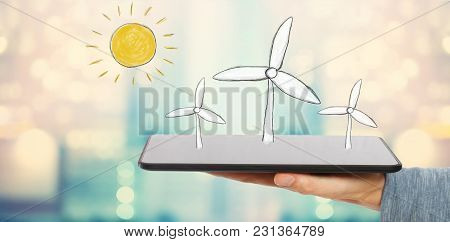 Windmills With Man Holding A Tablet Computer