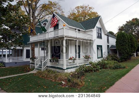 Bay View, Michigan / United States - October 16, 2017:  A White Two Story Victorian Cottage, With A