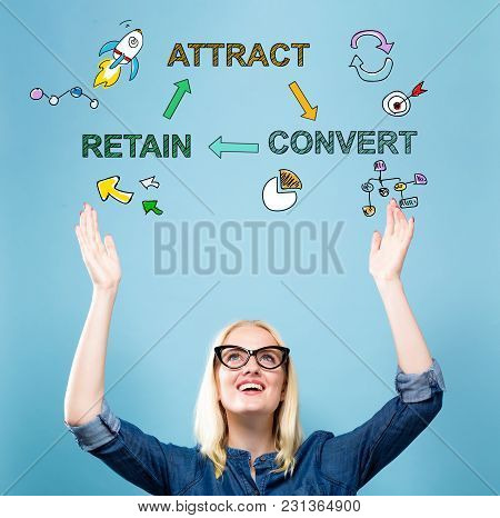 Attract Convert Retain With Young Woman Reaching And Looking Upwards