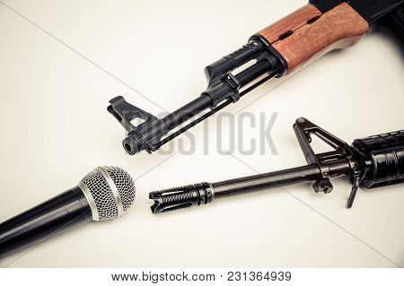Microphone Vs. Rifle / Freedom Of The Press Is At Risk Concept / World Press Freedom Day Concept