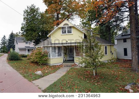 Bay View, Michigan / United States - October 16, 2017: A Yellow Two Story Single Family Cottage, Wit