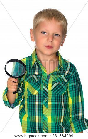 The Little Boy Looks Through The Magnifying Glass. The Concept Of The Game And Teaching The Sciences