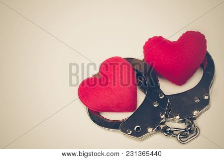 Handcuffs With A Red Love Heart With Copy Space To Add Text