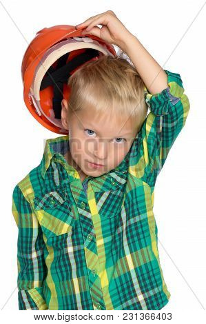 Little Boy In Construction Helmet. The Concept Of Professional Development Of A Child At An Early Ag