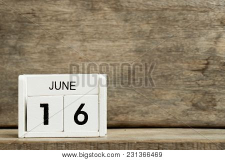 White Block Calendar Present Date 16 And Month June On Wood Background
