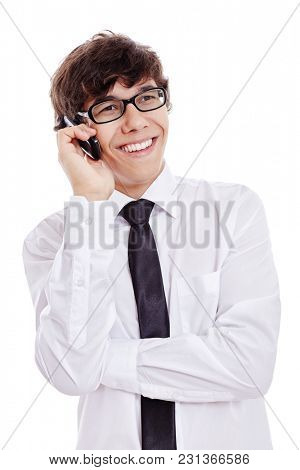Young hispanic man wearing black glasses, white shirt and black thin tie, smiling during phone talk isolated on white background - young professionals and communication concept