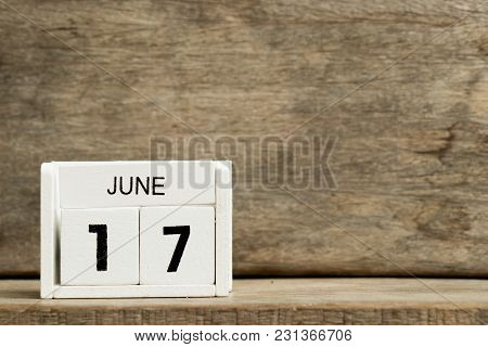 White Block Calendar Present Date 17 And Month June On Wood Background