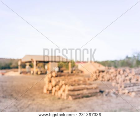 Blurred Sawmill With Logs And Sawdust Dull In Arkansas, Usa