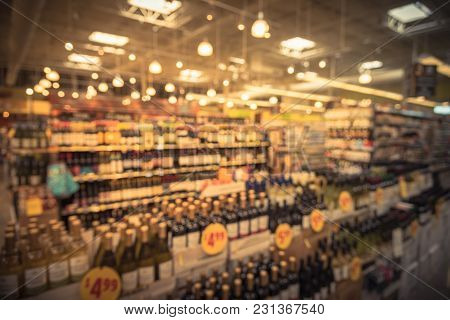 Blurred Abstract Wine Shelves With Price Tags At Supermarket In Usa