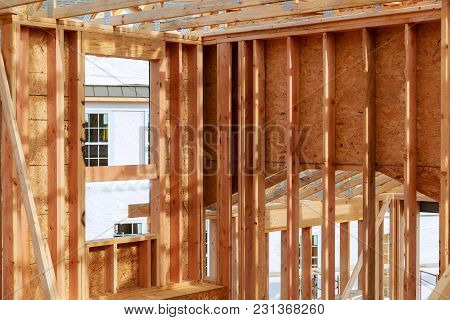 New Construction Home Framing New Build With Wooden Truss, Post And Beam Framework.