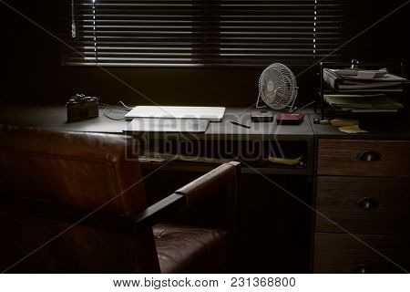 Work space on black table of a photographer or designer with laptop , retro camera and fan , Stylish