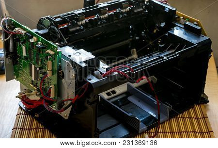 Disassembled Laser Printer With Wires And Motherboard