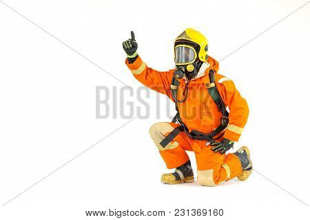 Firefighter In Uniform And Safety Helmet Standing Full Body Length