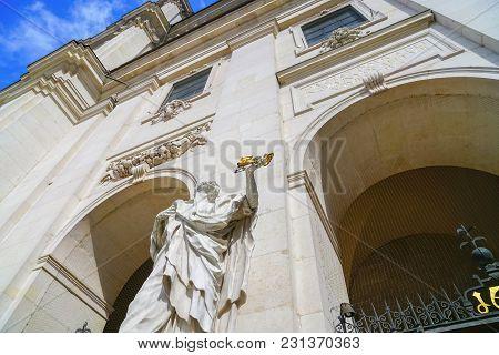 Statue Of Medieval Man Holding Keys , Including One Gold Key Aloft Outside Salzburg Cathedral