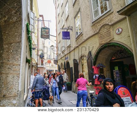 Salzburg, Austria - September 6 2017; People Moving Through Busy Narrow Street Of Historic Buildings