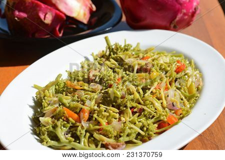 Spicy Carica Papaya Flowers Stir-fry. Javanese Traditional Food Called