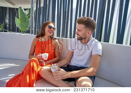 Young copule having coffee in lounge bar outdoor