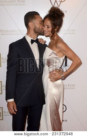 LOS ANGELES - MAR 13:  Kamar de los Reyes, Sherri Saum at the Fulfillment Fund Gala at Dolby Theater on March 13, 2018 in Los Angeles, CA