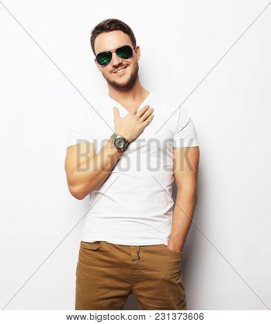 young man in smart wear, wearing fashion sunglasses