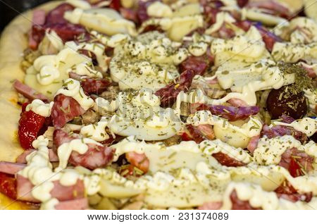 Cooking Homemade Pizza With Peppers, Plums, Ham, Sausage, Cheese And Spices, Closeup Selective Focus