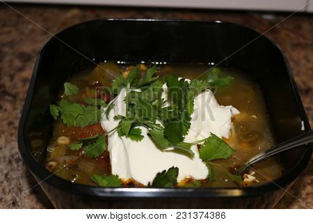 Fresh Hot South American Aztec Soup With Cream Also Garnished With Cilantro
