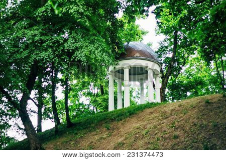 Stone Rotunda On A Hill In Gomel Park Among Trees With Green Foliage