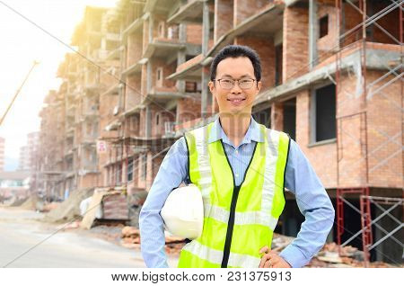 Middle Aged Asian Engineer At The Construction Site