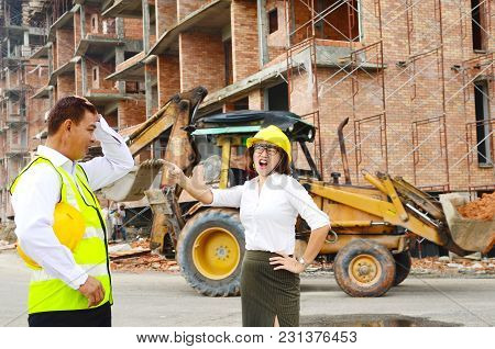 Asian Female Engineer Argued With Colleague At The Construction Site