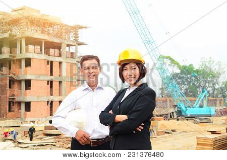 Asian Engineers At The Construction Construction Site