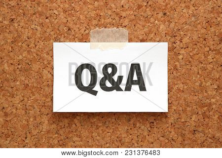 Q&a Or Questions And Answers On A Piece Of White Paper On A Brown Cork Board. Q&a Or Questions And A