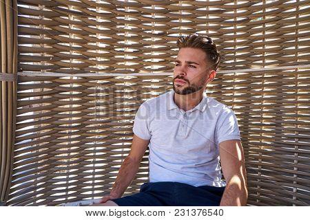 young beard man relaxed in a beach hammock