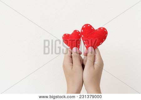 Two Hands Holding Two Red Hearts On White Background. Happy, Love, Valentines Day Idea, Sign, Symbol