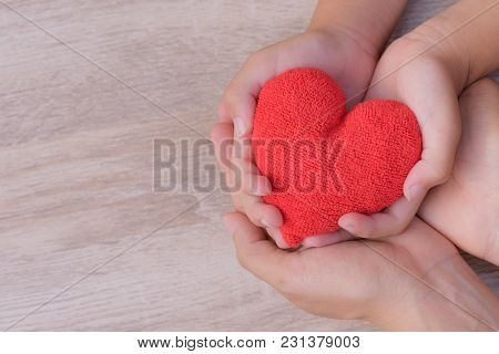 Health Care, Love, Organ Donation, Family Insurance And Csr Concept. Adult And Child Hands Holding H
