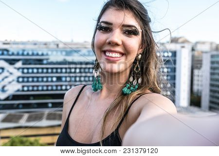 Make up Girl with Carnival Costume Taking a Selfie