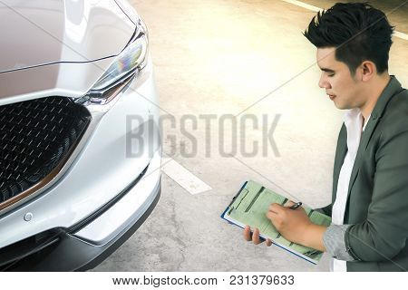 Man Asia Writing On Notepad Or Book, Paper With Car And Blurry Background. For Note, Transport, Busi