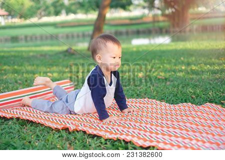 Cute Little Funny Smiling Asian 18 Months / 1 Year Old Toddler Baby Boy Child Practices Yoga In Cobr