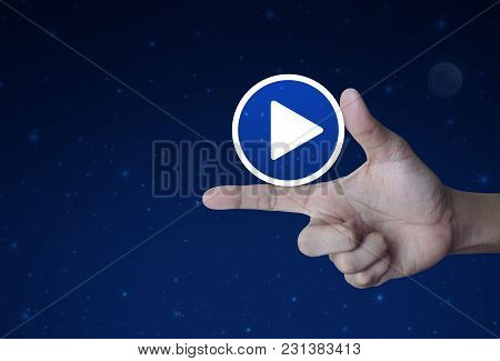 Play Button Icon On Finger Over Fantasy Night Sky And Moon, Business Music Online Concept