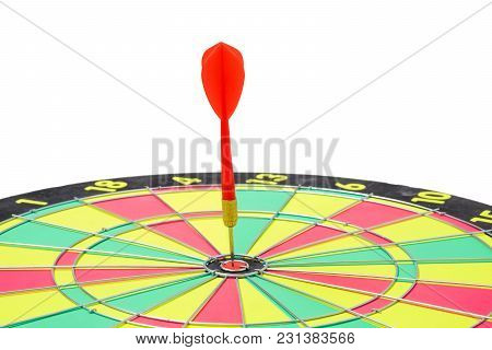 Close Up Of Dartboard With Red Dart Arrows In Center On White Background. Business Success Concept