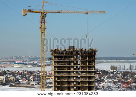 High Tower Crane Above A Skyscraper Building Site, Aerial View