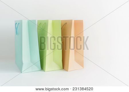 Empty New Color Paper Packages On A White Background